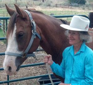 """TSB author Heather Smith Thomas and one of her ranch horses: a mare named """"Ed""""! Heather says that even now in her twenties, Ed is one of her best cow horses."""
