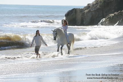 Frederic, Magali, and Dao on the beach in Malibu, California.