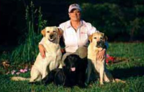 Lynn with her Labs. Photo by Cappy Jackson from THE RIDER'S GUIDE TO REAL COLLECTION.