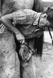 Heather Smith Thomas began shoeing her own horses when she was 14--here she shoes one of her ranch horses in the seventies.