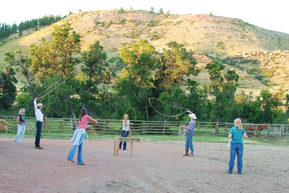 TSB Managing Director Martha Cook (right) and Senior Editor Rebecca Didier (left) struggle with the science of roping at the Padlock Ranch in Wyoming.