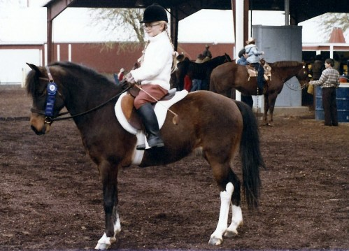 Black on her first show pony, Jaggers, at age seven.