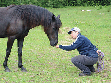 HORSE SPEAK author Sharon Wilsie greets her Morgan mare.