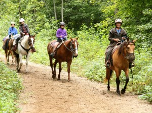 Willow and Jean leading a guided trail ride.