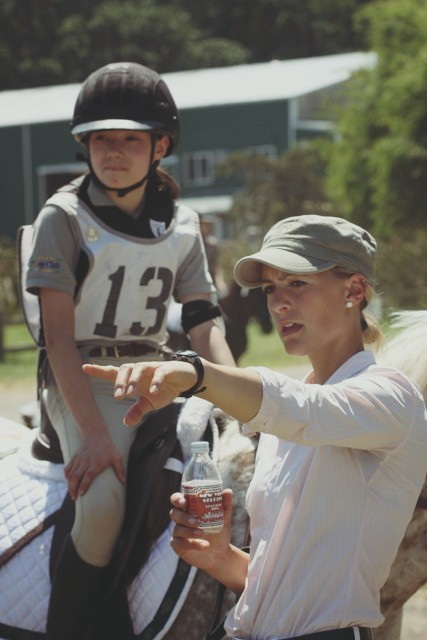 Kelsey coaching student Kaylee Leonard. Photo by Travis Leonard.